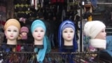 Mannequins in a shop show the head-scarf style officially promoted for women in Uzbekistan.