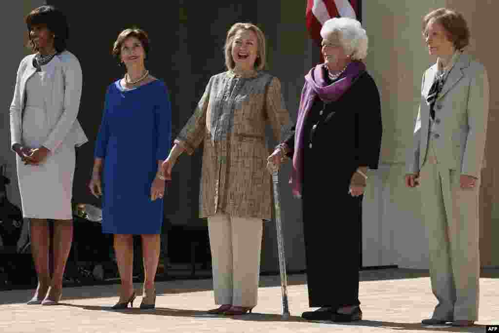 U.S. first lady Michelle Obama (left) and former first ladies Laura Bush, Hillary Clinton, Barbara Bush, and Rosalynn Carter attend the opening ceremony of the George W. Bush Presidential Center in Dallas, Texas. (AFP/Alex Wong/Getty Images)