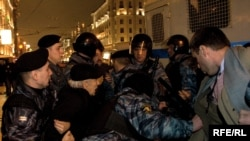 Riot police detain opposition activists at a protest of the Moscow City Duma elections.