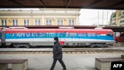 "Tensions increased after Serbia sent a train with the sign ""Kosovo is Serbia"" toward Kosovo's border."
