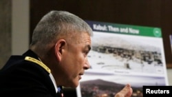 U.S. Army General John Campbell, the commander of the International Security Assistance Force, U.S. Forces-Afghanistan, appears before the Senate Armed Services Committee on Capitol Hill in Washington on February 12.