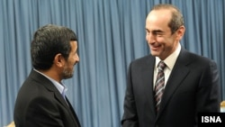 Iran's President Mahmud Ahmadinejad (left) meets with former Armenian President Robert Kocharian in Tehran on January 21.