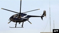 A private Blackwater helicopter flies over Baghdad