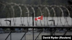 A Canadian flag flies outside of a Canadian correctional facility. File photo
