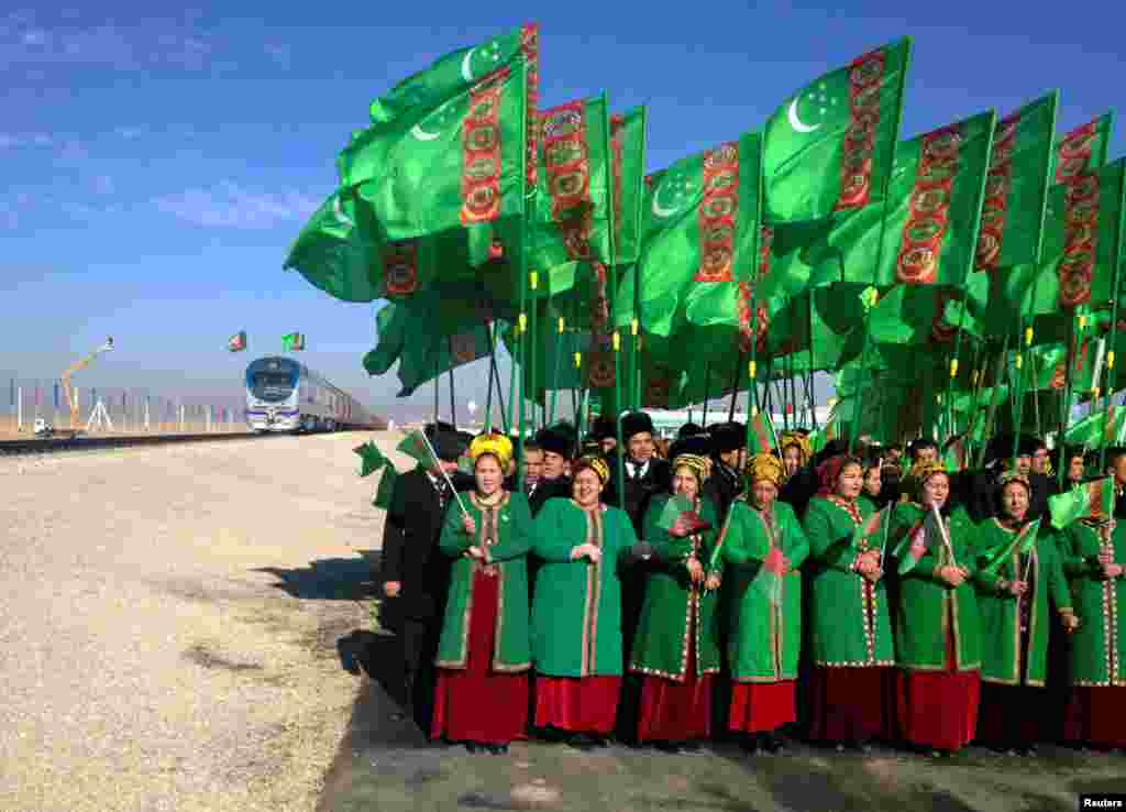People attend the opening ceremony of a railway link to Afghanistan at a customs control point in Turkmenistan. (Reuters/Marat Gurt)