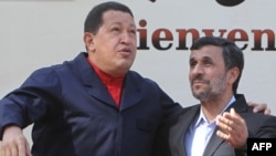Iran's President Mahmud Ahmadinejad (right) greets his Venezuelan counterpart Hugo Chavez in Tehran.