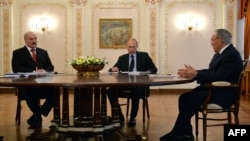 Russia -- (R-L) Kazakh president Nursultan Nazarbaev, Russian President Vladimir Putin and Belarus President Alyaksandr Lukashenka speak during their meeting in Putin's Novo-Ogaryovo residence outside Moscow, March 5, 2014