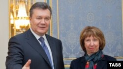 Ukrainian President Viktor Yanukovych (left) welcomes EU foreign-policy chief Catherine Ashton to Kyiv on December 10.
