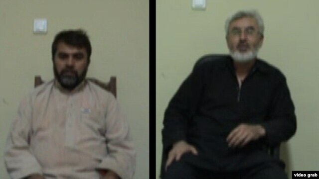 Afghan citizens Syed Kamal (in black) and Syed Hussain were arrested on charges of spying for Iran.