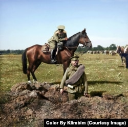 "A Russian soldier stands in a hole blasted by a shell during World War I. Shirnina says she loves bringing such moments from Russian history to a wider audience and reminding people that ""the world has always been full of color, even in war."""