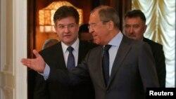 Сергій Лавров (п), Мирослав Лайчак на переговорах у Москві, 19 травня 2014 року