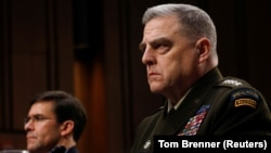 """U.S. Chairman of the Joint Chiefs of Staff Gen. Mark A. Milley testifies beside U.S. Defense Secretary Mark Esper before a Senate Armed Services Committee hearing on """"Department of Defense Budget Posture"""" on Capitol Hill in Washington, March 4, 2020"""