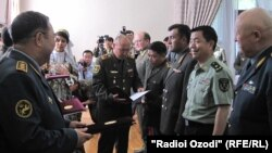 Military officials gather in Tajikistan ahead of the exercises on June 8.