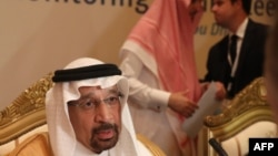 Saudi Energy Minister Khalid al-Falih listens to journalists questions during a meeting of the Joint Ministerial Monitoring Committee in the Emirati capital Abu Dhabi on November 11, 2018. - Saudi Arabia said it will trim oil exports by 500,000 barrels pe