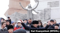 Kazakh human rights activists demonstrate in Almaty on December 16.