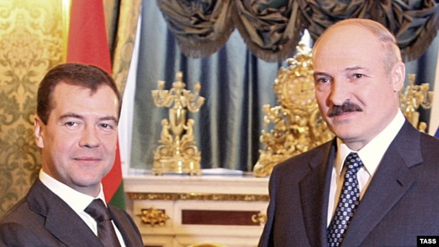 The EU is worried that Belarusian President Alyaksandr Lukashenka (right) arrives in Prague as a proxy of Russia and President Dmitry Medvedev.