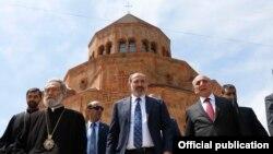 Nagorno-Karabakh -- Armenian Prime Minister Nikol Pashinian (C), Karabakh President Bako Sahakian (R) and Archbishop Pargev Martirosian leave a newly built church in Stepanakert, May 9, 2019.