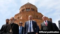 Nagorno-Karabakh -- Armenian Prime Minister Nikol Pashinian (C), Karabakh leader Bako Sahakian (R) and Archbishop Pargev Martirosian leave a newly built church in Stepanakert, May 9, 2019.