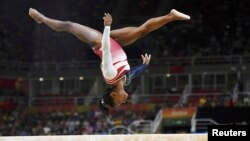 American gymnast Simone Biles faltered on the balance beam and failed to win an expected fourth gold medal at the Rio Olympics.