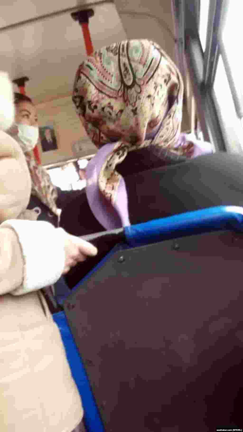 Passengers on board a bus in Ashgabat, Turkmenistan