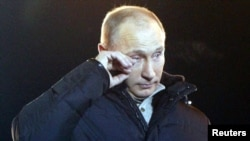 Russia -- Vladimir Putin wipes tears as he addresses supporters during a rally in Manezh Square near the Kremlin in central Moscow, 04Mar2012