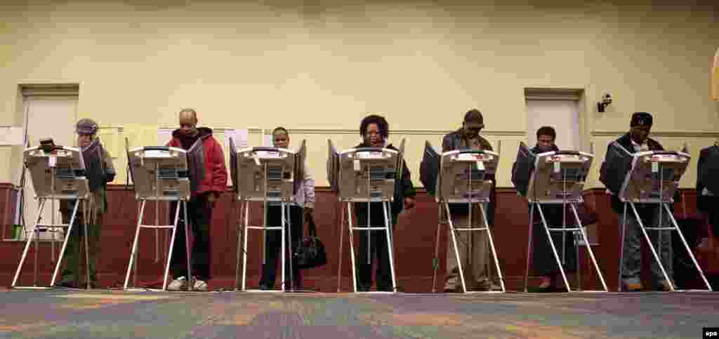 People vote at the Toledo Lucas County Library in Toledo, Ohio.