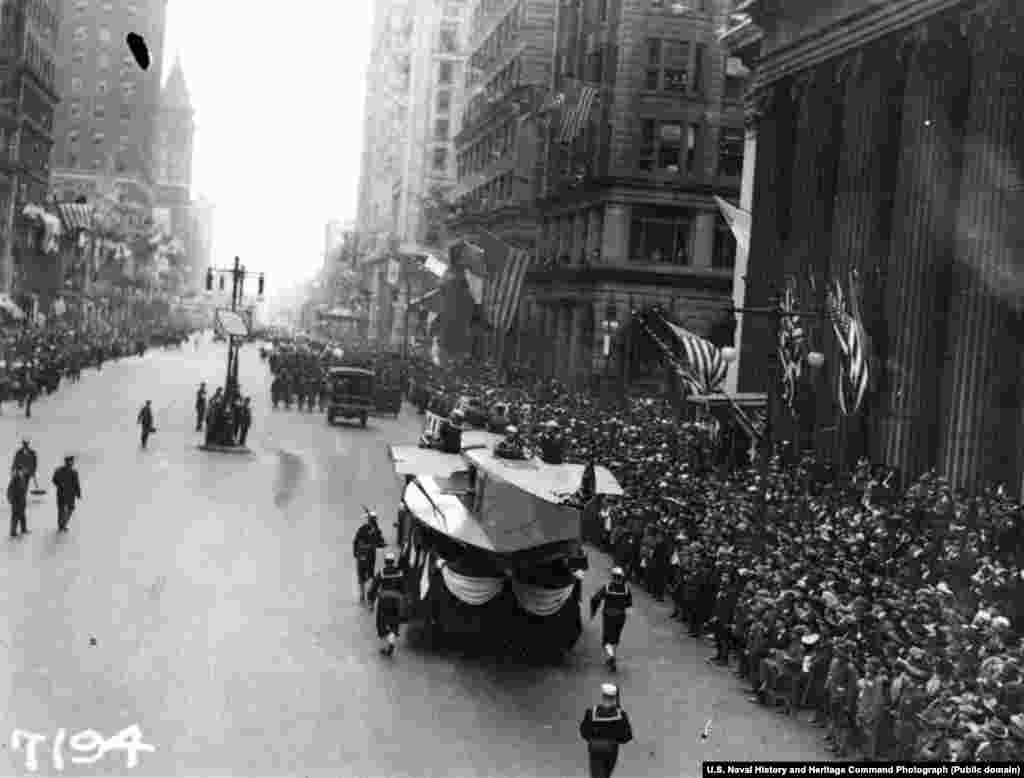 The Naval Aircraft Factory float moves down Philadelphia's Broad Street during a Liberty Loan Parade on September 28, 1918. The parade was organized to raise funds for the U.S. government during World War I. But the event took place as the deadly Spanish flu was spreading around the globe. The day before the parade, Philadelphia recorded 118 people with influenza.