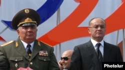 Armenia - Defense Minister Seyran Ohanian (R) and Yuri Khachaturov, chief of the Armenian army's General Staff, watch a military parade in Yerevan, 21Sept2011.