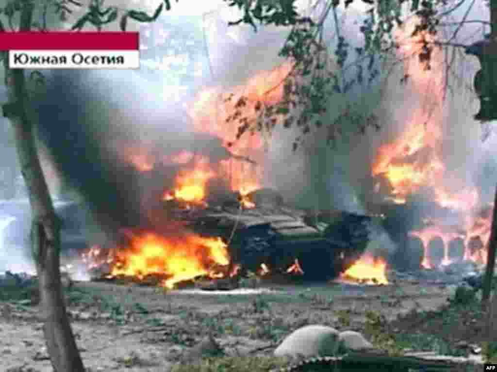 A Russian Channel One television grab shows a Georgian tank burning in Tskhinvali. A top Russian military commander said more than 10 Russian peacekeepers were killed during fighting in the South Ossetian capital.