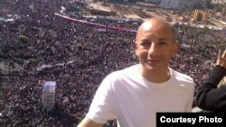 Khaled Fahmy, history professor at the American University in Cairo, stands in front of crowds in Egypt's Tahrir Square.