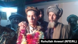 Afghan soldier abducted by the Taliban reunited with his father.