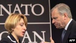 Georgian Foreign Minister Eka Tkeshelashvili (left) tried to put a positive spin on NATO chief Jaap de Hoop Scheffer's news.