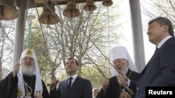 Patriarch Kirill (left); Russian President Dmitry Medvedev; Vladimir, Metropolitan of Kyiv and all Ukraine; and Ukrainian President Viktor Yanukovych ring bells at the St. Ilyinski church in Chornobyl.