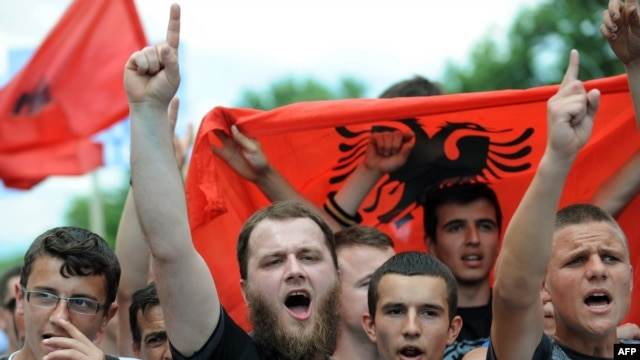 People protest in the Macedonian capital on May 11 against the arrest of six people over their alleged involvement in last month's murder of five people near Skopje.