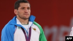 O'zbekistonlik kurashchi Soslan Tigiev London olimpiadasida.