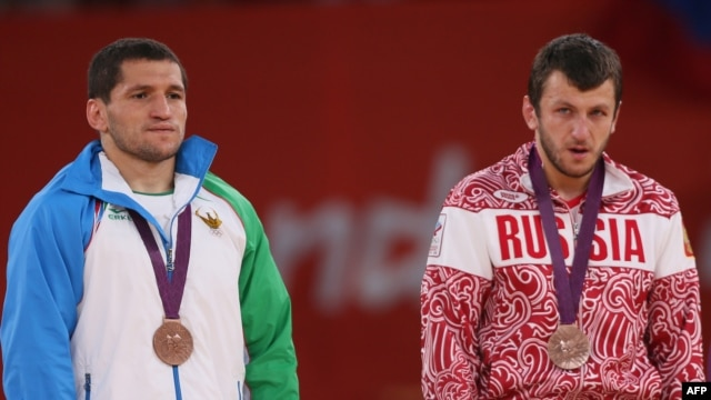 Uzbekistan's Soslan Tigiev (left) with Russia's Denis Tsargush on the podium at the London 2012 Olympic Games in August.