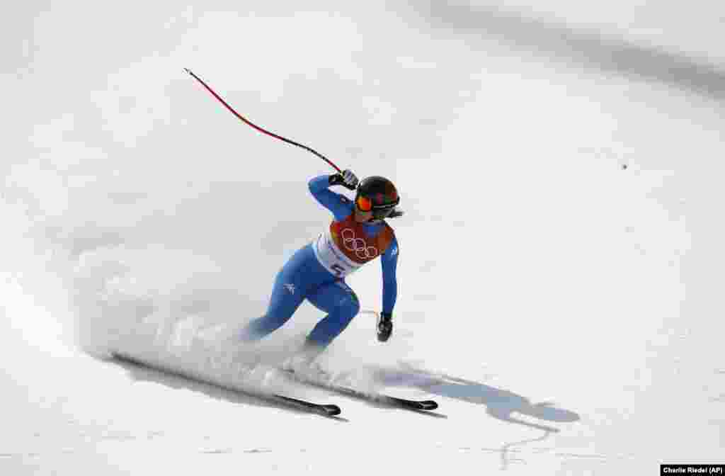 Alpine Skiing: Italy's Sofia Goggia comes to a stop in the women's downhill at the 2018 Winter Olympics in Jeongseon, South Korea, Wednesday, Feb. 21, 2018. Sofia took gold.