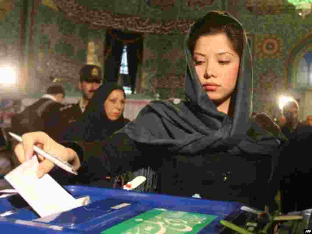 An Iranian woman casts her ballot at a polling station in Tehran. - An Iranian woman casts her ballot at a polling station in Tehran on March 14, 2008. Iran voted today in elections expected to tighten a conservative grip on parliament after a low-key campaign and the mass disqualification of reformist candidates by a hardline vetting body