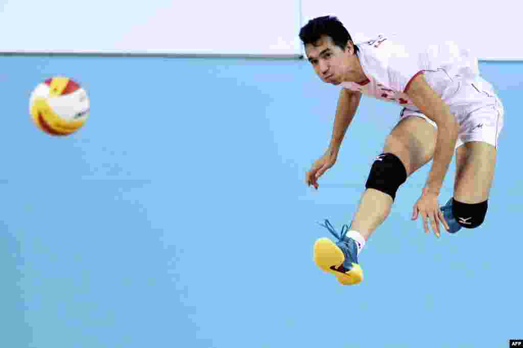 Iran's Seyed Mohammad Moussavi Eraghi serves during the men's volleyball final between Japan and Iran at the Songnim Gymnasium in Incheon, South Korea, during the 17th Asian Games. Iran won gold. (AFP/Martin Bureau)