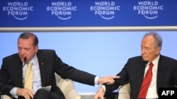 Recep Tayyip Erdogan (left) took exception to getting cut off in his reponse to Shimon Peres in Davos.