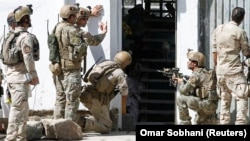 Afghan security forces at the site of an attack on a Shi'ite Muslim mosque in Kabul on August 25