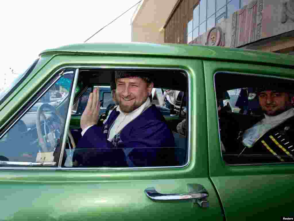 Chechen leader Ramzan Kadyrov, dressed in national costume, takes the wheel of a vintage Russian Volga during Chechen Language Day celebrations in Grozny. Photo by S. Dal for Reuters