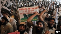 Supporters of the banned Pakistani hard-line Islamic group Jamaat ud-Dawa shout anti-U.S. slogans during a protest in Lahore against drone attacks in Pakistani tribal areas.