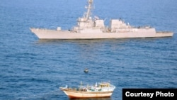"An image released by the U.S. Navy shows the ""USS Kidd"" near the Iranian-flagged dhow ""Al Molai,"" which reportedly issued distress call claiming a pirate attack."