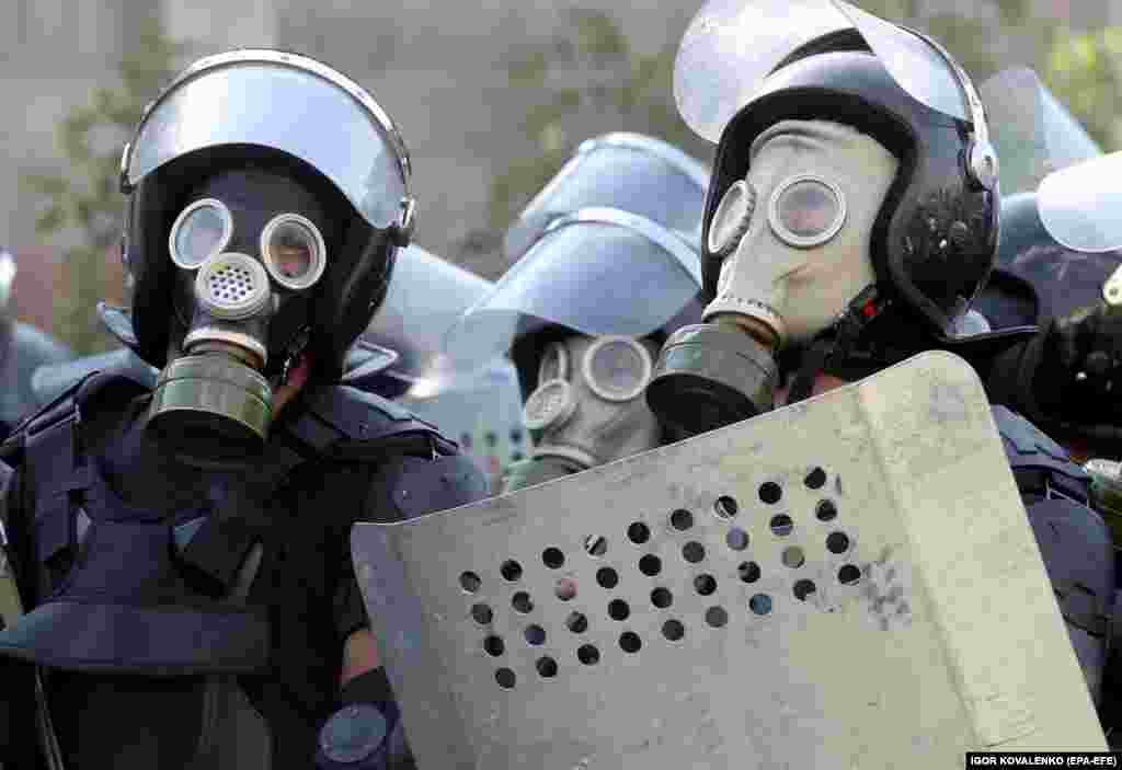 Police in gas masks during the August 8 operation. After an initial attempt to seize the former president ended on August 7 in the death of a member of the special forces and dozens of people injured, Kyrgyz authorities mustered an overwhelming police force for a second raid on the compound.