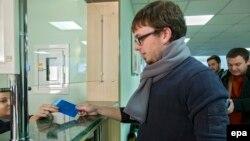 A Moldovan citizen presents his passport at customs at Chisinau International Airport.