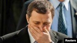 Baş nazir Vlad Filat parlamentdə onun hökumətinə etimadsızlıq göstərilməsi barədə qərardan sonra zalı tərk edir. 5 mart 2013
