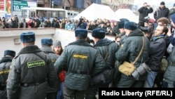 Police monitor the protest in Moscow