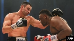 Vitaliy Klitschko sizes up British opponent Dereck Chisora in a defense of his WBC World Heavyweight Championship title in Munich in February.