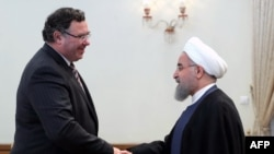 Iranian President Hassan Rohani (R) meets with Patrick Pouyanne Chairman and CEO of French energy company Total, after signing an offshore gas field agreement in Tehran, July 3, 2017
